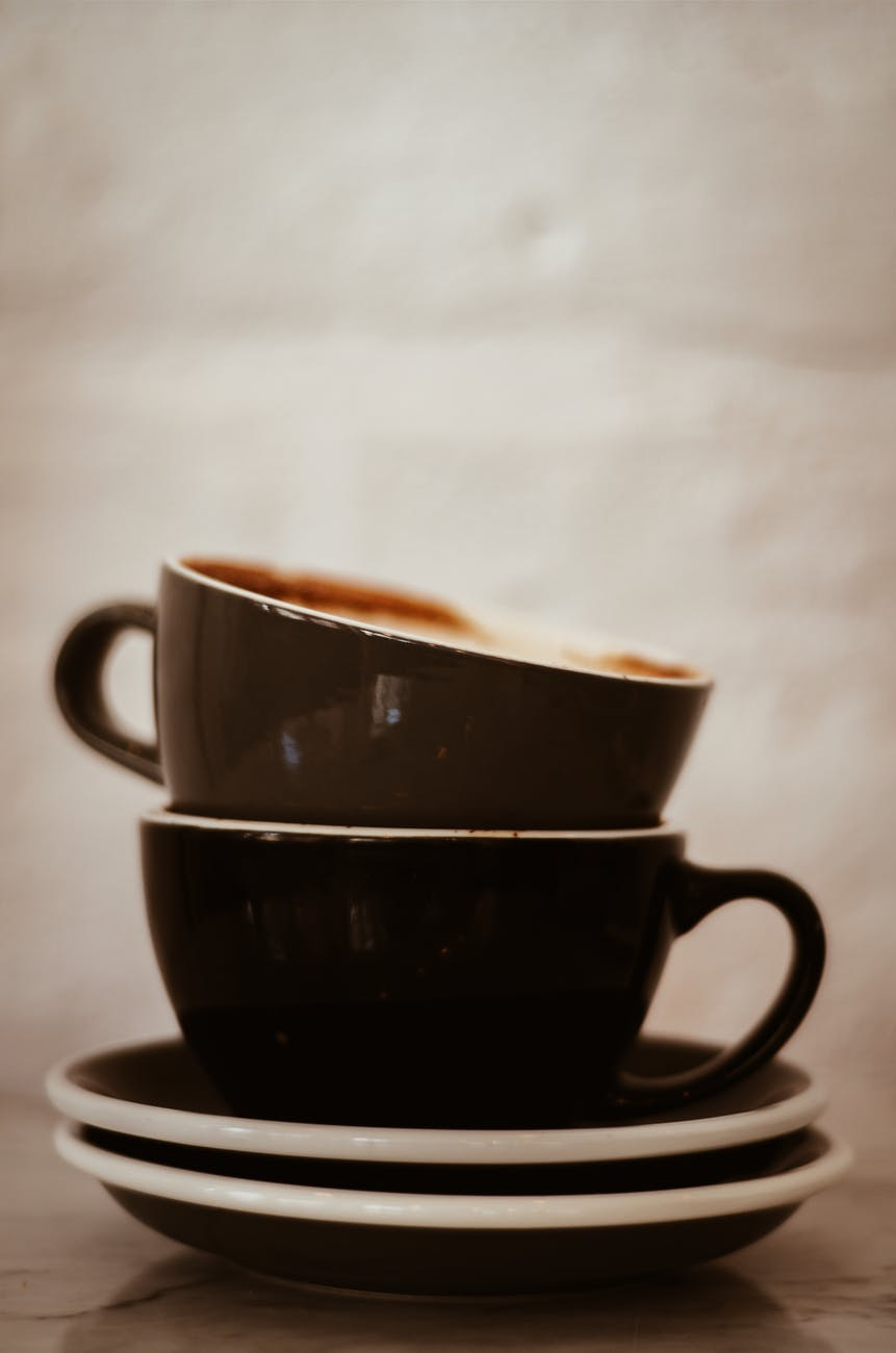 two black and brown teacups